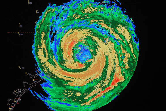 A video monitor, at the National Hurricane Center in Miami, shows an enhanced radar image of Hurricane Ike as it comes ashore on Galveston, Texas, at about 3:10 a.m. ET Saturday, Sept. 13, 2008. According to forecasters, Ike arrived as a strong Category 2 storm with maximum sustained winds of about 110 mph.