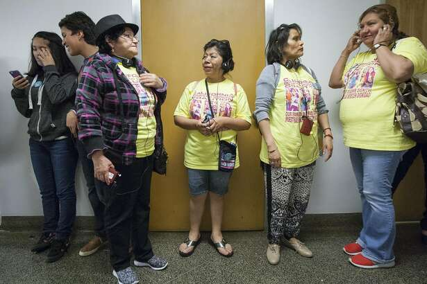 "Luz Sampedro, center, chats with Francisca Vasquez as they wait inside the California State Capitol for the Senate Labor Committee's vote on SB 1015 on April 6, 2016 in Sacramento, California. The bill, also known as the ""2016 Domestic Worker Bill of Rights,"" would eliminate the 2017 expiration date of AB 241, which grants overtime protection to domestic workers in private homes."