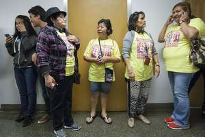"""Luz Sampedro, center, chats with Francisca Vasquez as they wait inside the California State Capitol for the Senate Labor Committee's vote on SB 1015 on April 6, 2016 in Sacramento, California. The bill, also known as the """"2016 Domestic Worker Bill of Rights,"""" would eliminate the 2017 expiration date of AB 241, which grants overtime protection to domestic workers in private homes."""