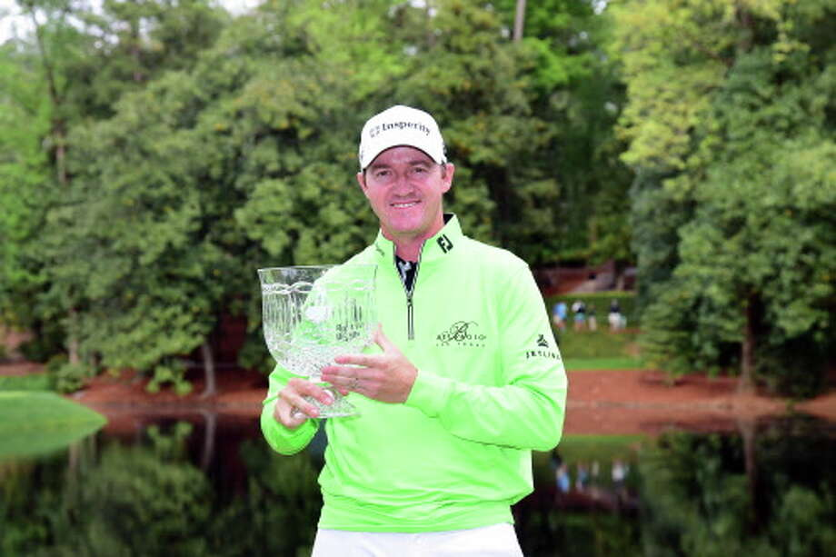 AUGUSTA, GEORGIA - APRIL 06:  Jimmy Walker of the United States holds the winner's trophy after the Par 3 Contest prior to the start of the 2016 Masters Tournament at Augusta National Golf Club on April 6, 2016 in Augusta, Georgia.  (Photo by Harry How/Getty Images) Photo: Harry How, AP / 2016 Getty Images