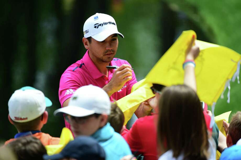Jason Day, the top-ranked player, signs autographs during the Par 3 contest Wednesday at Augusta National Golf Club in Augusta, Ga. Photo: Harry How / Getty Images / 2016 Getty Images
