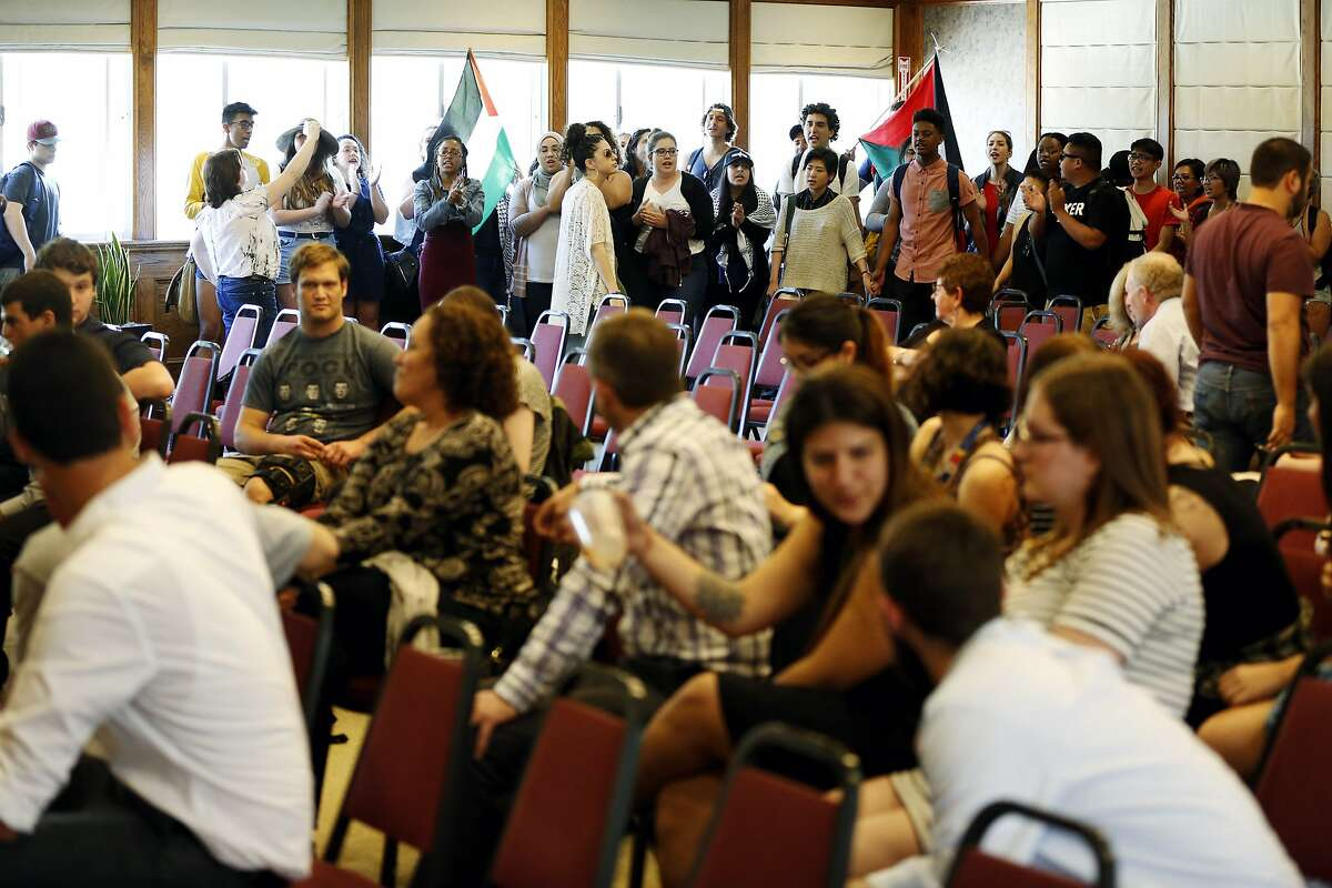 Students from the General Union of Palestine Students and other organizations protest mayor of Jerusalem Nir Barkat's speech at Seven Hills Conference Center on San Francisco State University campus in San Francisco, California, on Wednesday, April 6, 2016.