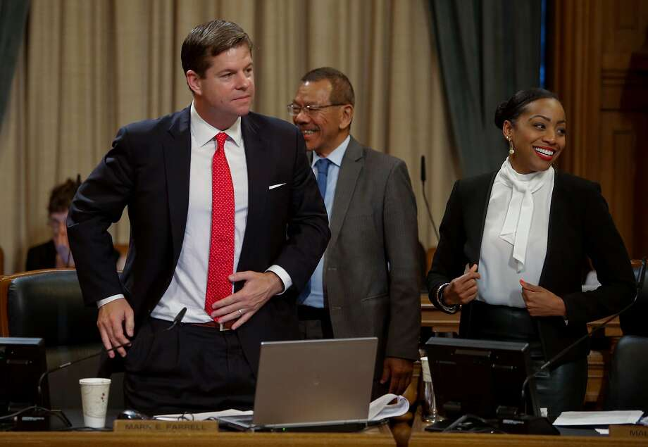Supervisor Norman Yee, (center) congratulates fellow supervisor  Mark Farrell, (left) as the San Francisco Board of Supervisors voted to pass the ordinance sponsored by Supervisor Mark Farrell and Mayor Ed Lee to regulate Airbnb and other short term rental services in San Francisco, Calif., on Tues. July 14, 2015. Supervisor Malia Cohen is close by. Photo: Michael Macor, The Chronicle