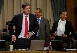 Supervisor Norman Yee, (center) congratulates fellow supervisor  Mark Farrell, (left) as the San Francisco Board of Supervisors voted to pass the ordinance sponsored by Supervisor Mark Farrell and Mayor Ed Lee to regulate Airbnb and other short term rental services in San Francisco, Calif., on Tues. July 14, 2015. Supervisor Malia Cohen is close by.