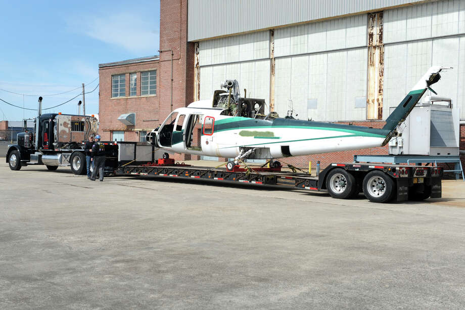 A Sikorsky S76 helicopter arrives by a flatbed trailer at the Connecticut Air and Space Center, in Stratford, Conn. April 6, 2016. The helicopter will be used for parts in the restoration of some of the center's other aircraft. Photo: Ned Gerard / Hearst Connecticut Media / Connecticut Post