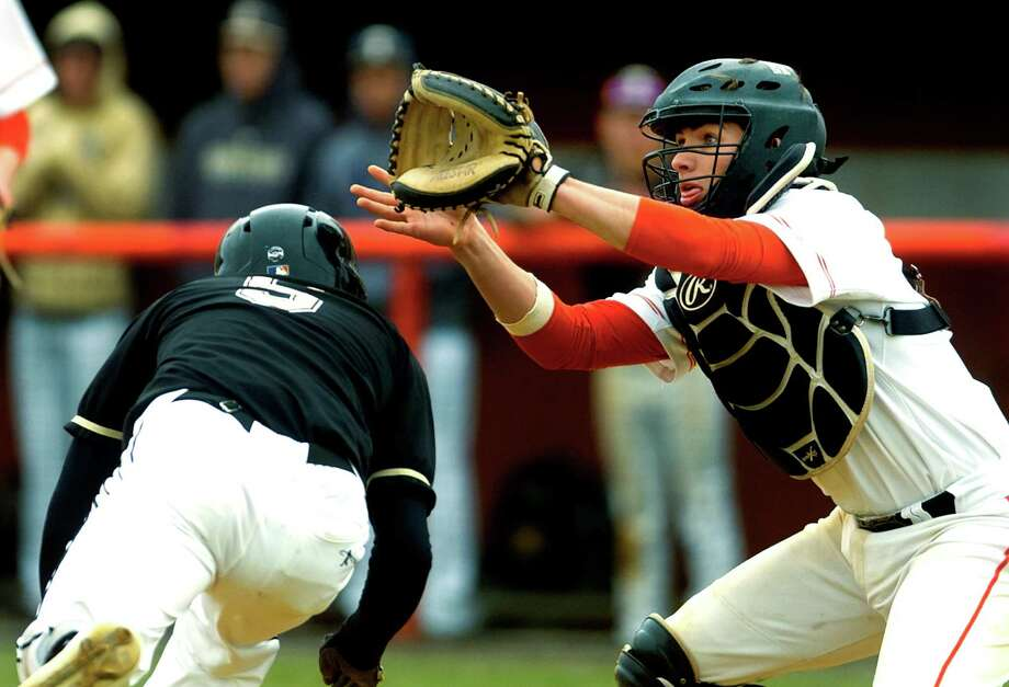 Fairfield Prep's Biagio Paoletta waits for the ball at the plate as Trumbull's Daniel Ruchalski beats the tag to score during baseball action at Fairfield University in Fairfield, Conn., on Wednesday Apr. 6, 2016. Photo: Christian Abraham / Hearst Connecticut Media / Connecticut Post