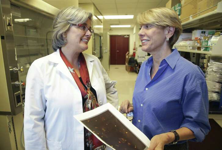File photo of Vivienne Rebel (left), executive vice president of research and development of biotech company bioAffinity Technologies Inc., talking with CEO Maria Zannes. The San Antonio-based cancer diagnostics company is working to commercialize a non-invasive diagnostic test to detect early stage lung cancer.