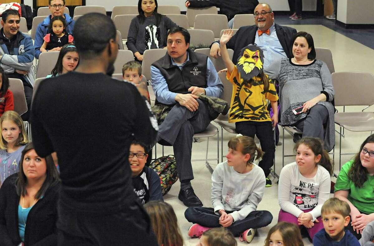 Makayla Straight, 5, of Niskayuna raises her hand as Russell Joel Brown, a bass and MufasaOs understudy in Disney's