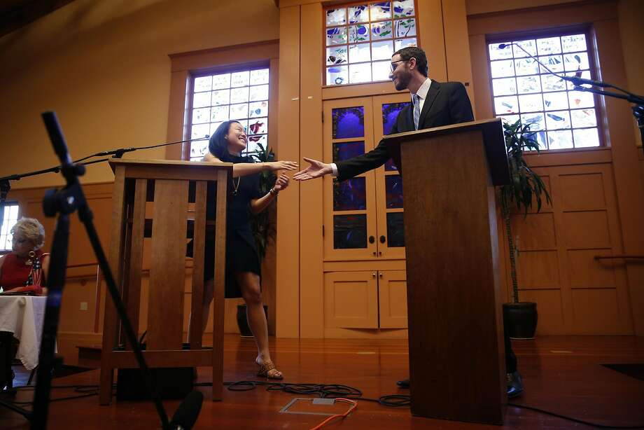 Jane Kim shakes hands with Scott Wiener at the start of their District 11 State Senatorial debate at Congregation Sha'ar Zahav in San Francisco, Calif., on Wednesday, April 6, 2016. Photo: Scott Strazzante, The Chronicle