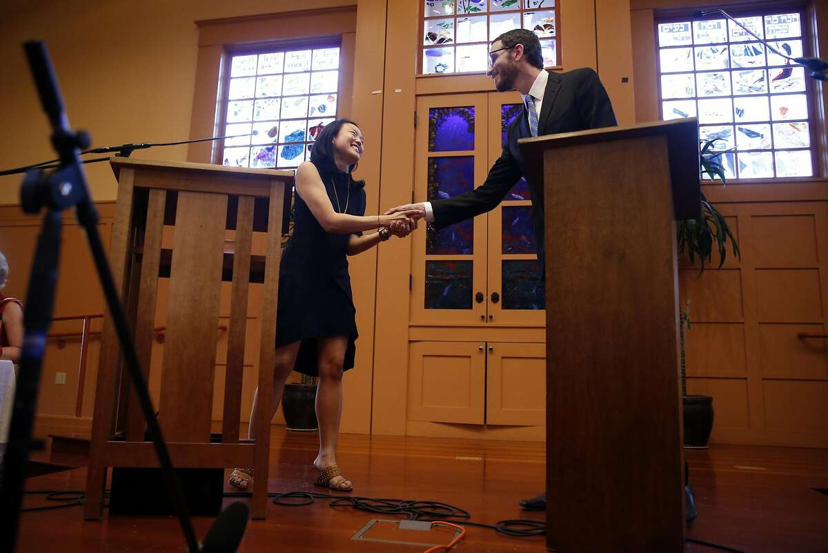 Jane Kim shakes hands with Scott Wiener at the start of their District 11 State Senatorial debate at Congregation Sha'ar Zahav in San Francisco, Calif., on Wednesday, April 6, 2016.