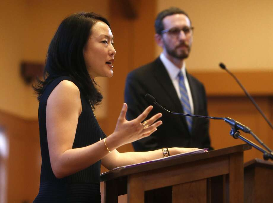 S.F. Supervisors Jane Kim and Scott Wiener, shown debating in April, are in a tight race for a coveted state Senate seat, and major contributions are being filtered through committees. Photo: Scott Strazzante, The Chronicle