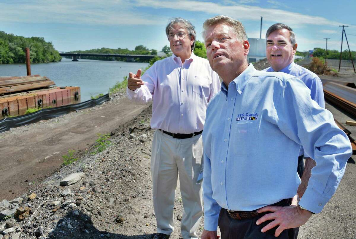 Galesi Group CEO Dave Buicko, left, state Canal Corp Director Brian Stratton and Schenectady Mayor Gary McCarthy, right, at the bike path and riverwalk for Mohawk Harbor at the Rivers Casino site on Erie Blvd. Tuesday July 21, 2015 in Schenectady, NY. The state Canal Corporation will become a subsidiary of the New York Power Authority on Jan. 1. (John Carl D'Annibale / Times Union archive)