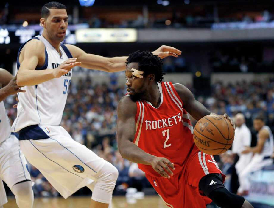 Houston Rockets guard Patrick Beverley (2) tries to drive to the basket as Dallas Mavericks center Salah Mejri, left, defends during the first half of an NBA basketball game, Wednesday, April 6, 2016, in Dallas. Photo: Ron Jenkins, AP / FR171331 AP