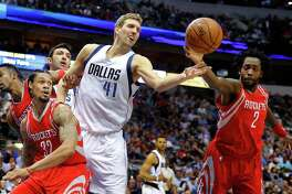 The Mavs' Dirk Nowitzki, left, and Pat Beverley both want the ball Wednesday.