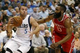 Dallas Mavericks guard J.J. Barea (5) drives as Houston Rockets guard James Harden (13) defends during the second half of an NBA basketball game, Wednesday, April 6, 2016, in Dallas. The Mavericks won 88-86. (AP Photo/Ron Jenkins)