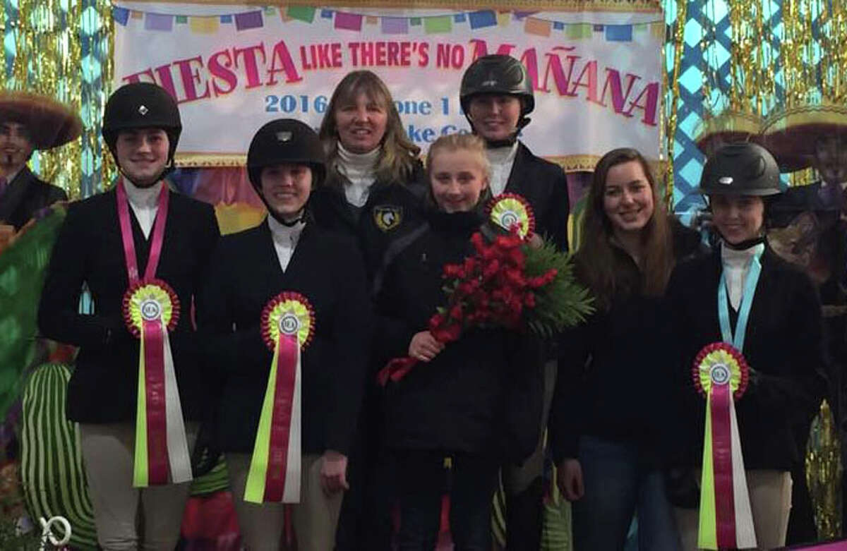 The Cavalier Farm Upper School IEA Team recently won Reserve Champion at the Zone 1 (New England) finals held March 25-26 at Mount Holyoke College. The team has qualified for the National Finals at Kentucky Horse Park slated for April 20-24. The riders are, from left to right, Annie Fournier, Jordan Guilmart, coach Cheryl LeMoine , Devon Lemoine, Chelsea LeMoine, Julia Lineweber and Alycia Petrauskas. Cavalier Farm is located in New Milford.