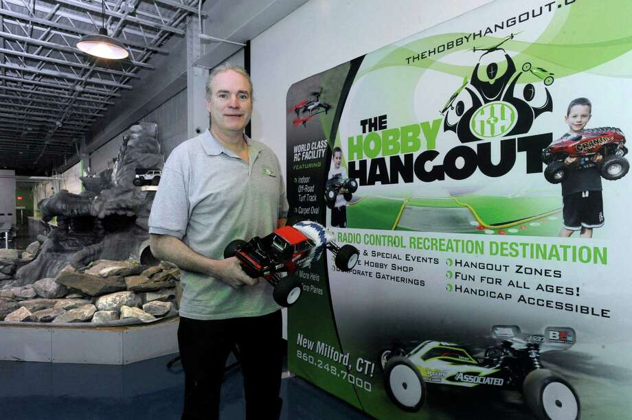 John Gallagher and business partner Greg Vogel will open The Hobby Hangout, a radio control car and drone race facility, Saturday in New Milford. Photo: Carol Kaliff / Hearst Connecticut Media / The News-Times