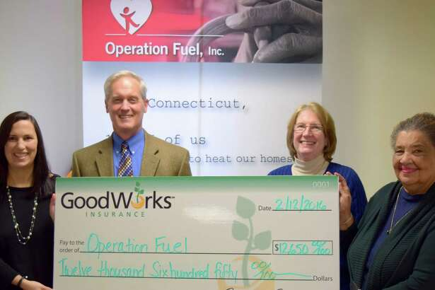 GoodWorks Insurance, which has an office in New Milford, recently donated $12,650 to Operation Fuel as part of a collaboration with the Connecticut Energy Marketers Association (CEMA), which donated $2,650, for a total donation of $15,300. Pictured from left are, Operation Fuel's Director of Development Kim O'Brien Green, GoodWorks Senior Vice President Curt Johnson, Nancy Bulkeley, chairperson of Operation Fuels board and Senior Community Affairs Representative for Dominion Resources, and Operation Fuels Executive Director Patricia Wrice.