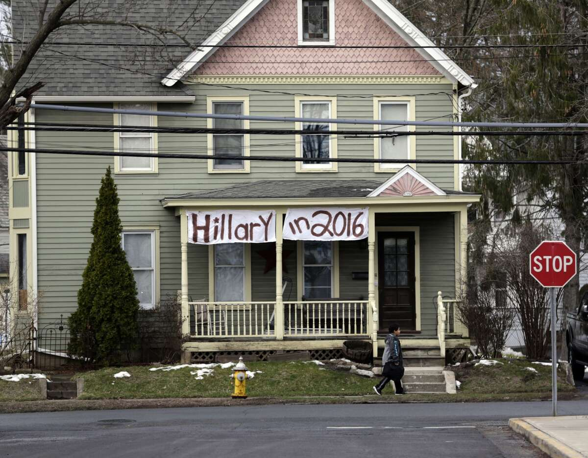 A sign for Democratic Presidential candidate Hillary Clinton hangs on a house across the street from where Republican presidential candidate Sen. Ted Cruz, R-Texas, is scheduled to hold a campaign event, Thursday, April 7, 2016, at Mekeel Christian Academy in Scotia, N.Y. (Mike Groll / AP)