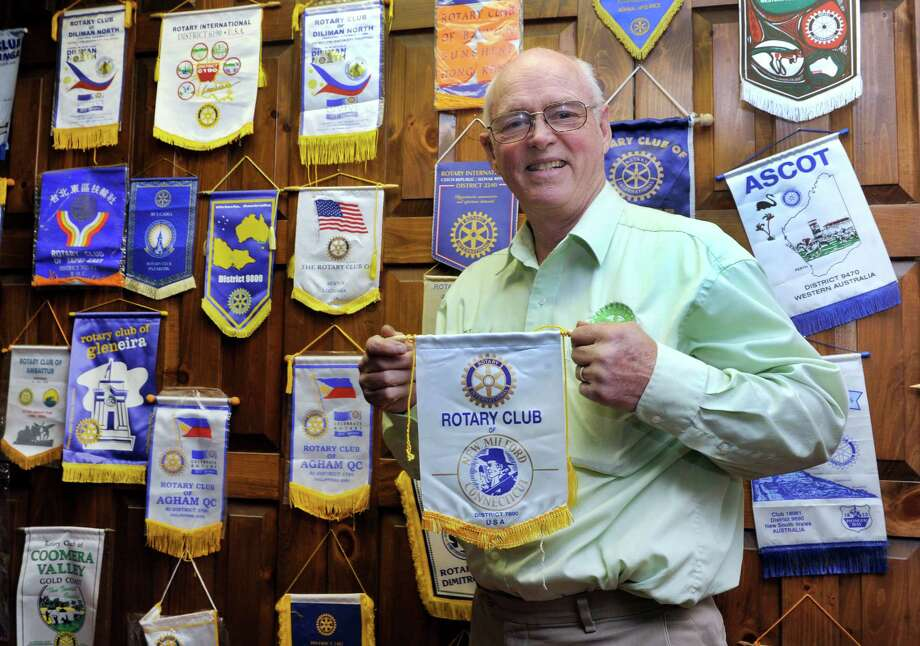 Frank Wargo, with flags given to him by Rotary Clubs he has visited around the world. Wargo teaches leadership skills to Rotary leaders. Photo: Carol Kaliff / Hearst Connecticut Media / The News-Times