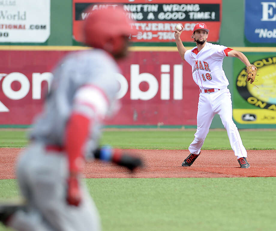 Lamar's Stijn Van Der Meer throws to first as the runner makes his way up the baseline as the Cardinals battle with Nicholls during Wednesday's home game. Photo taken Wednesday, April 6, 2016 Kim Brent/The Enterprise Photo: Kim Brent / Beaumont Enterprise