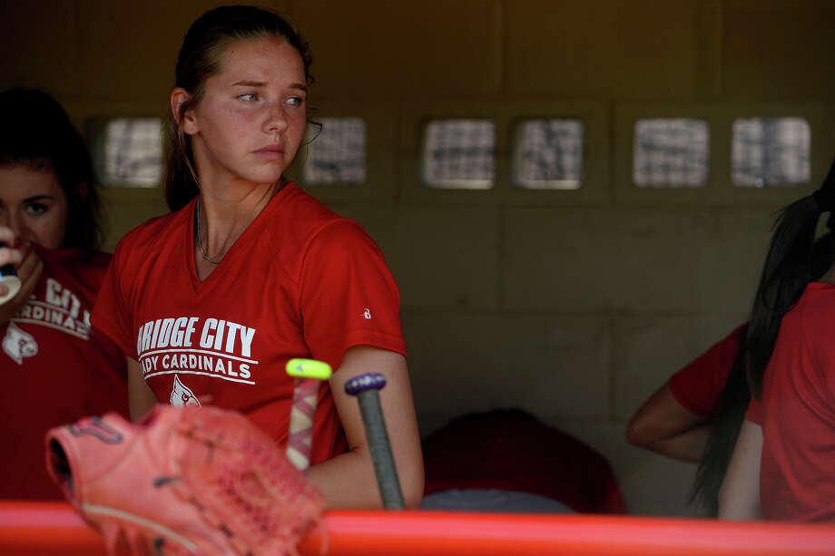 Bridge City's Kassidy Wilbur gathers her equipment in the dugout during practice on Wednesday.  Photo taken Wednesday 4/6/16 Ryan Pelham/The Enterprise Photo: Ryan Pelham / ©2016 The Beaumont Enterprise/Ryan Pelham