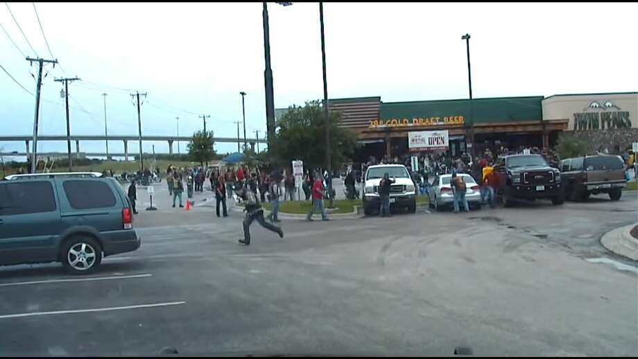 Raw footage from a Waco police dashboard camera on May 17, 2015 shootout between bikers at a Twin Peaks restaurant in Waco shows at least one person getting gunned down during the melee. Photo: Screenshot Via YouTube