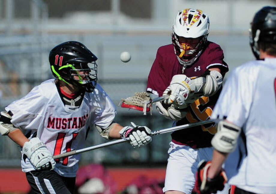 Jake Fuss (11) will be one of the leaders for the Mustangs this spring as Warde looks to improve on its 7-9 record from last season and make a return trip to the state tournament. Photo: Christian Abraham / Christian Abraham / Connecticut Post
