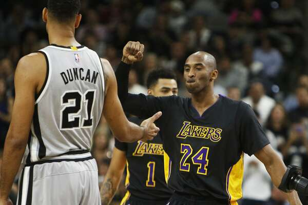 SAN ANTONIO, TX - DECEMBER 11: Kobe Bryant #24 of the Los Angeles Lakers greets Tim Duncan #21 of the San Antonio Spurs before the game at AT&T Center on December 11, 2015 in San Antonio,Texas. NOTE TO USER: User expressly acknowledges and agrees that, by downloading and/or using this Photograph, user is consenting to the terms and conditions of the Getty Images License Agreement. (Photo by Ron Cortes/Getty Images)