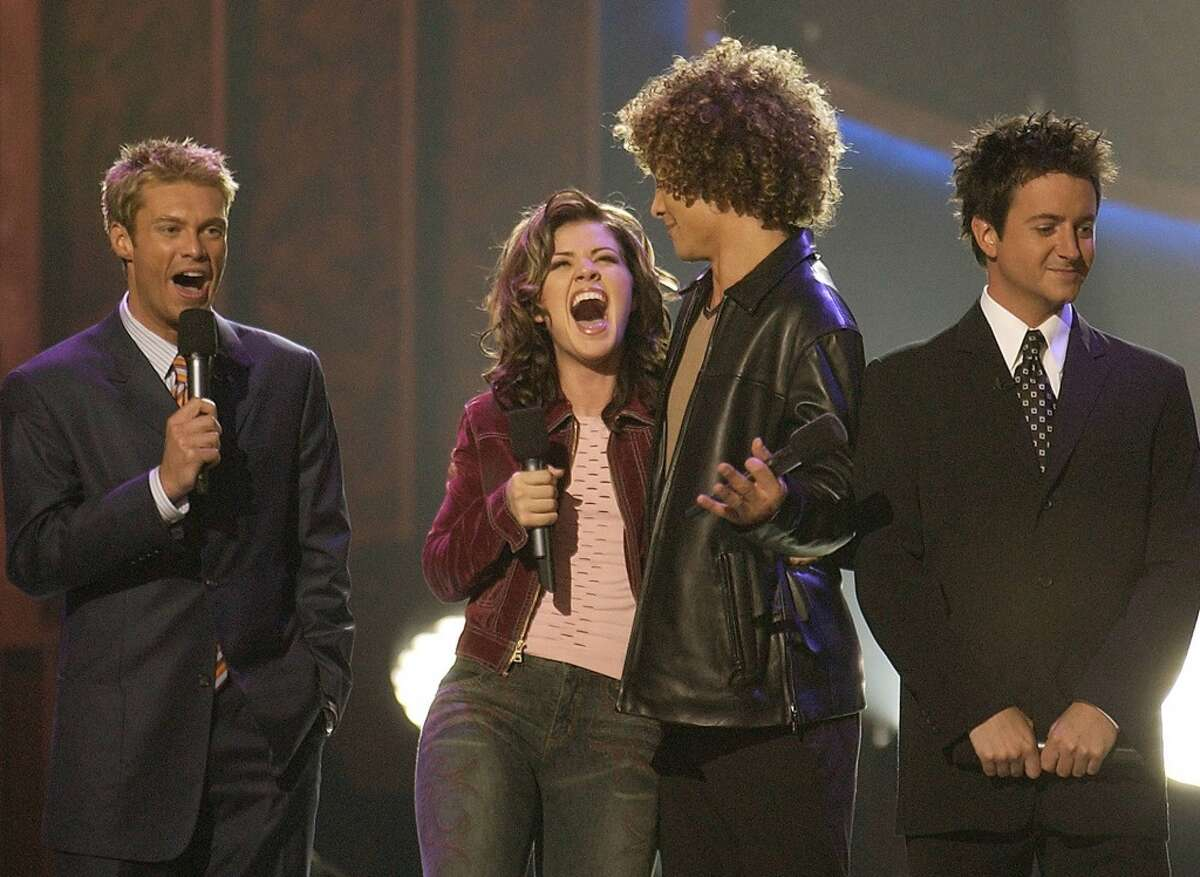 WINNING IDOL MOMENTS Ryan Seacrest, Kelly Clarkson, Justin Guarini and BrianDunkleman find out who is America's first Idol.