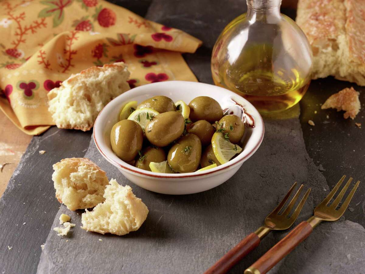 Kroger stores will be celebrating the flavors of Spain during a two-week event called Savor World Flavor: Taste of Spain. The promotion (running through April 19) will bring authentic Spanish foods to the supermarket as well recipes and in-store sampling to highlight the joys of Spanish cuisine. Shown: Marinated olives with lemon.
