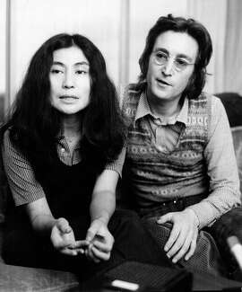 12/19/1971 - Yoko Ono and John Lennon speak with reporter at The Warwick Hotel Sunday afternoon about being blocked from visiting with Ono's 8-year-old daughter, Kyoko, by her former husband, Anthony Cox. Cox was given temporary custody fo the child from Harris County District Judge Peter Solito in September. Ono was awarded visitation rights during the same hearing.