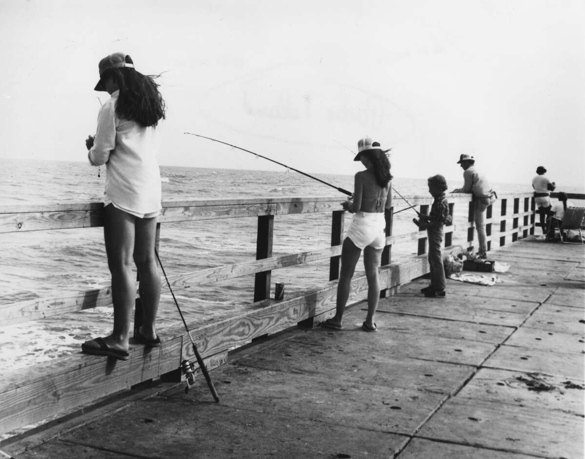 2. The 70-mile long park is just one portion of the 130-mile long Padre Island, which extends from east of Corpus Christi to Port Isabel.This photo from 1993 shows men and women fishing on the Bob Hall Pier on Padre Island, just north of the park's boundaries.