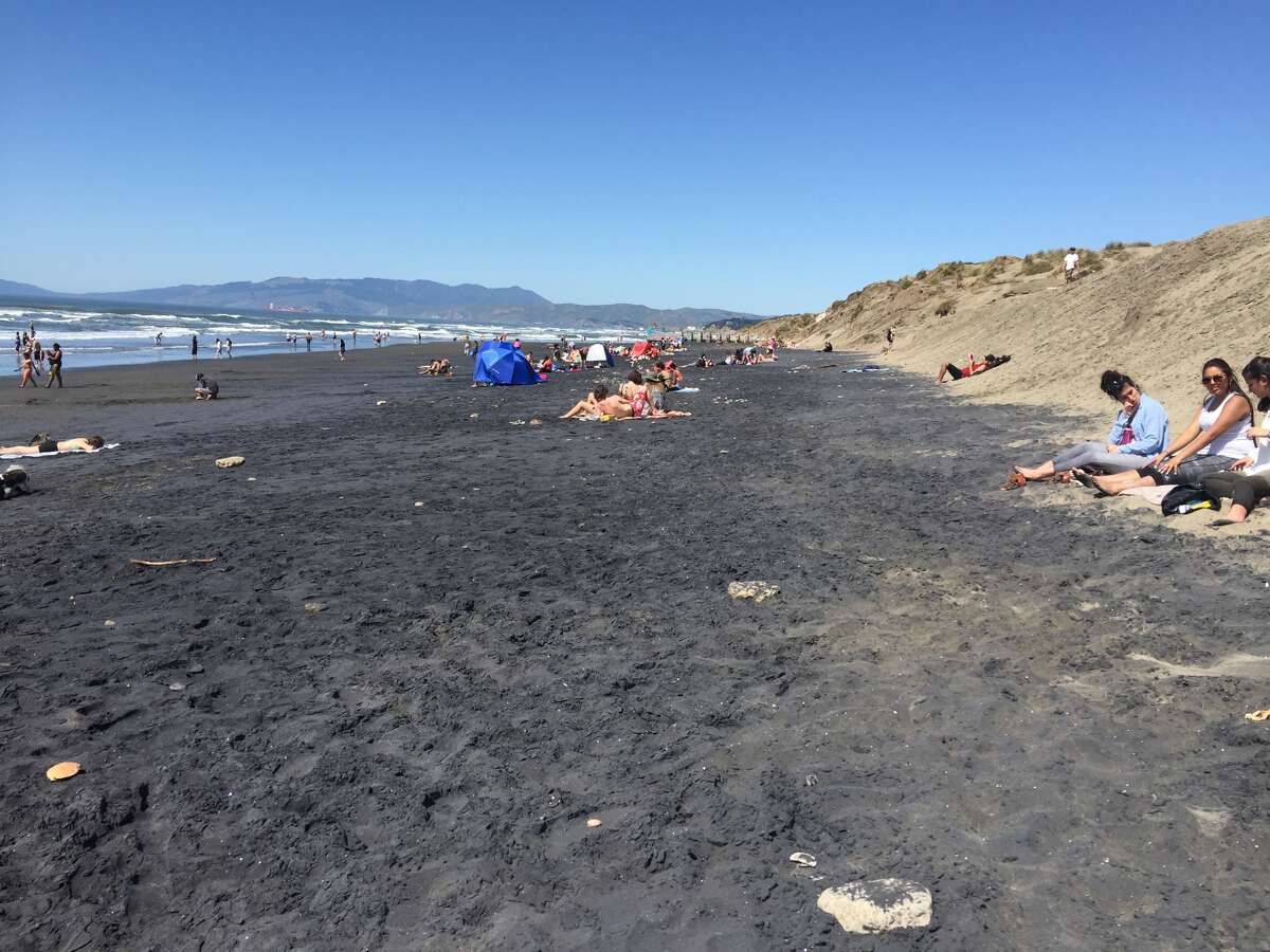 Black magnetite sand covered a large portion of San Francisco's Ocean Beach on April 7, 2016.