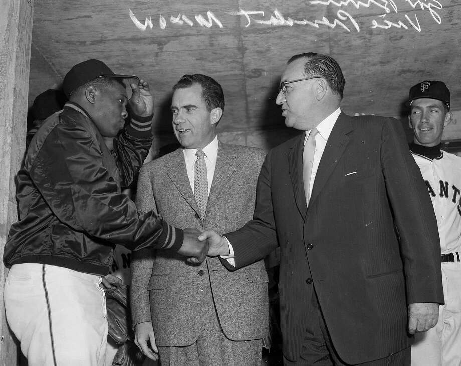 April 12, 1960: San Francisco Giant Willie Mays tips his cap upon meeting Richard Nixon in the dugout before Opening Day at Candlestick Park. Photo: Bob Campbell, The Chronicle