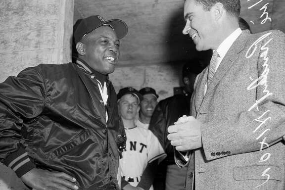 April 12, 1960: San Francisco Giant Willie Mays chats with then Vice- President Richard Nixon in the dugout before Opening Day at Candlestick Park.