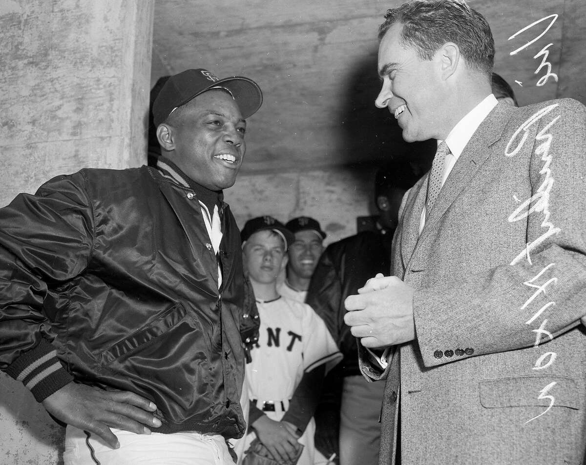 On April 12, 1960, San Francisco Giant Willie Mays chats with then Vice President Richard Nixon in the dugout before opening day at Candlestick Park.