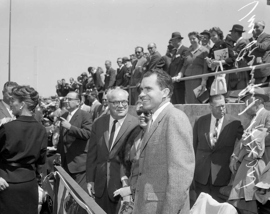 Vice President Richard Nixon take in the scene before opening day at Candlestick Park on April 12, 1960, the first baseball game at the stadium. Photo: Bob Campbell, The Chronicle