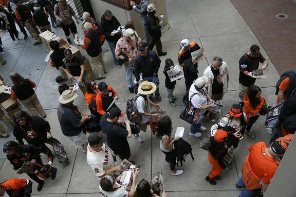 Fans stream into the ballpark as the San Francisco Giants get set to take on the Los Angeles Dodgers during opening day of the 2016 MLB season, at AT&T Park in San Francisco, California on Thurs. April 7, 2016.
