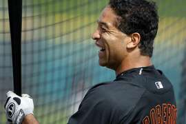 San Francisco Giants #10 Dave Roberts share a laugh with teammates while waiting his turn at bat Tuesday at Scottsdale Stadium during their spring training baseball workouts in Ariz. By Lance Iversen/The San Francisco Chronicle