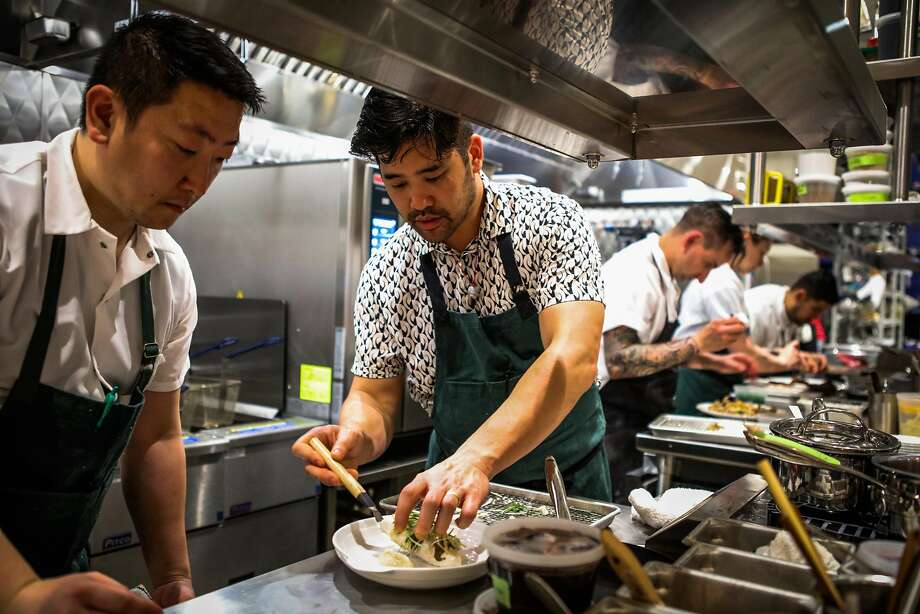 Left: Chef Brandon Jew (second from left) prepares Cantonese dishes with a California influence. Photo: Gabrielle Lurie, Special To The Chronicle