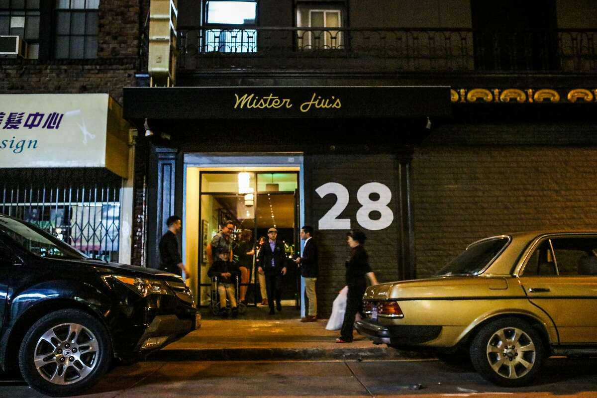 Guests exit Mister Jiu's restaurant after a family and friends meal, in San Francisco, California, on Wednesday, April 6, 2016.