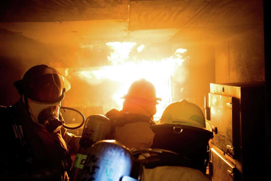 WSF seamen put out a mock stovetop fire during a refresher course at Bremerton International Emergency Services Training Center's Ordinary Seaman Fire Training School on Wednesday, April 6, 2016. Photo: GRANT HINDSLEY, SEATTLEPI.COM / SEATTLEPI.COM