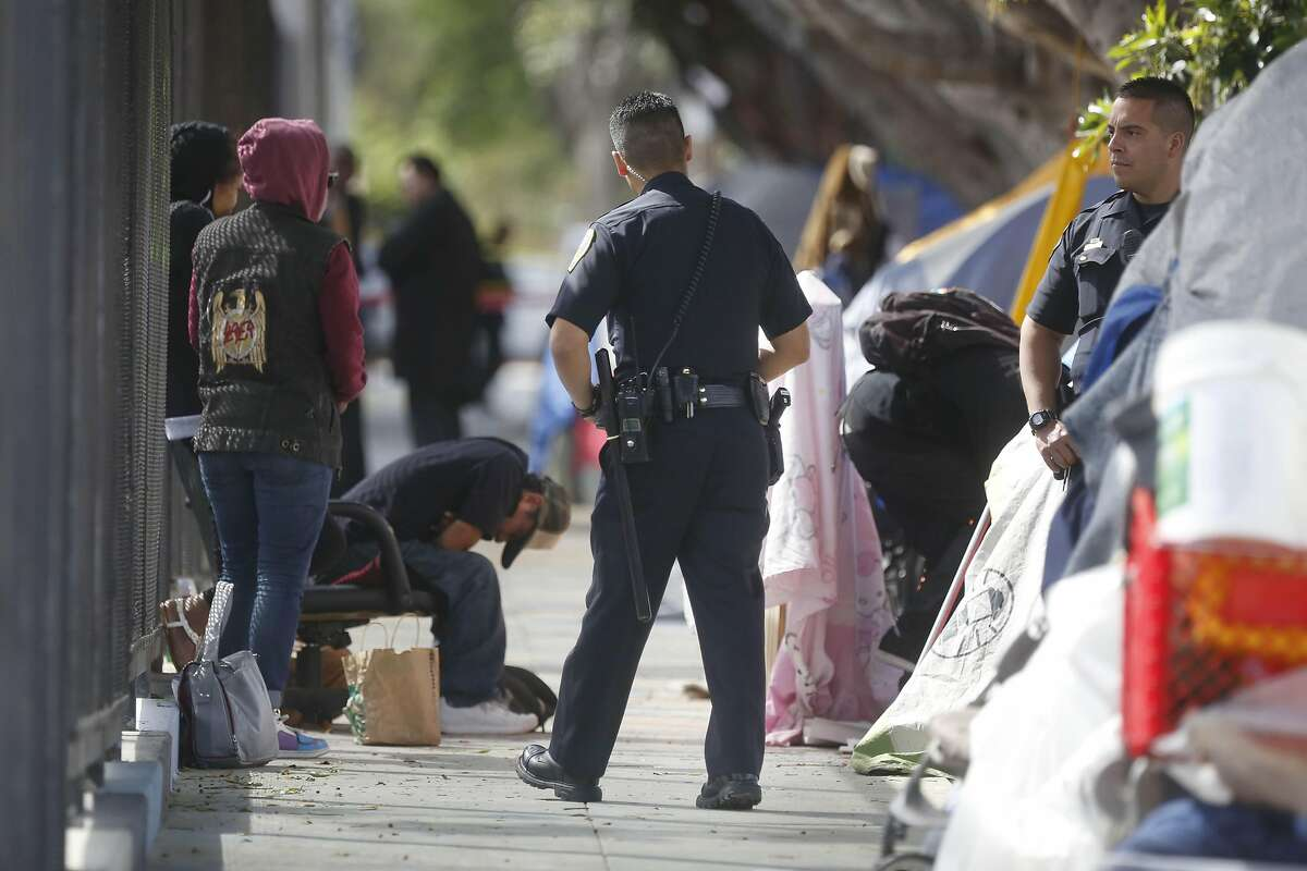 Members of the SFPD investigate at a homeless encampment along Shotwell Street between 18th and 19th Streets after an officer involved shooting on Thursday, April 7, 2016 in San Francisco.