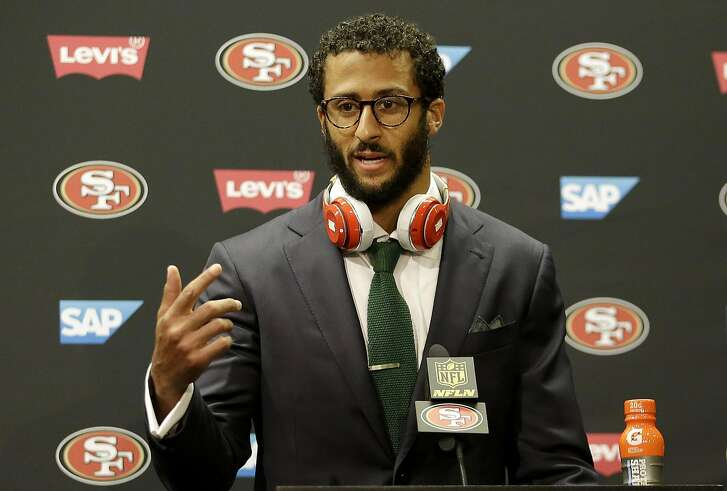 FILE - In this Oct. 18, 2015, file photo, San Francisco 49ers quarterback Colin Kaepernick speaks at a news conference after an NFL football game against the Baltimore Ravens in Santa Clara, Calif. The choice for the San Francisco 49ers might come down to paying Colin Kaepernick $11.9 million to wear their uniform in 2016 or $4.9 million to wear Denver's. (AP Photo/Marcio Jose Sanchez, File)