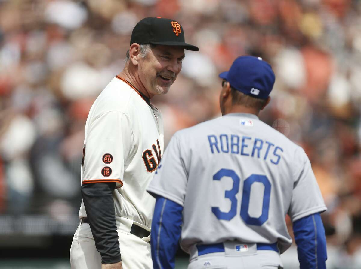 San Francisco Giants manager Bruce Bochy talks with Los Angeles Dodgers manager Dave Roberts before the home opening game on Thursday, April 7, 2016 in San Francisco, Calif.