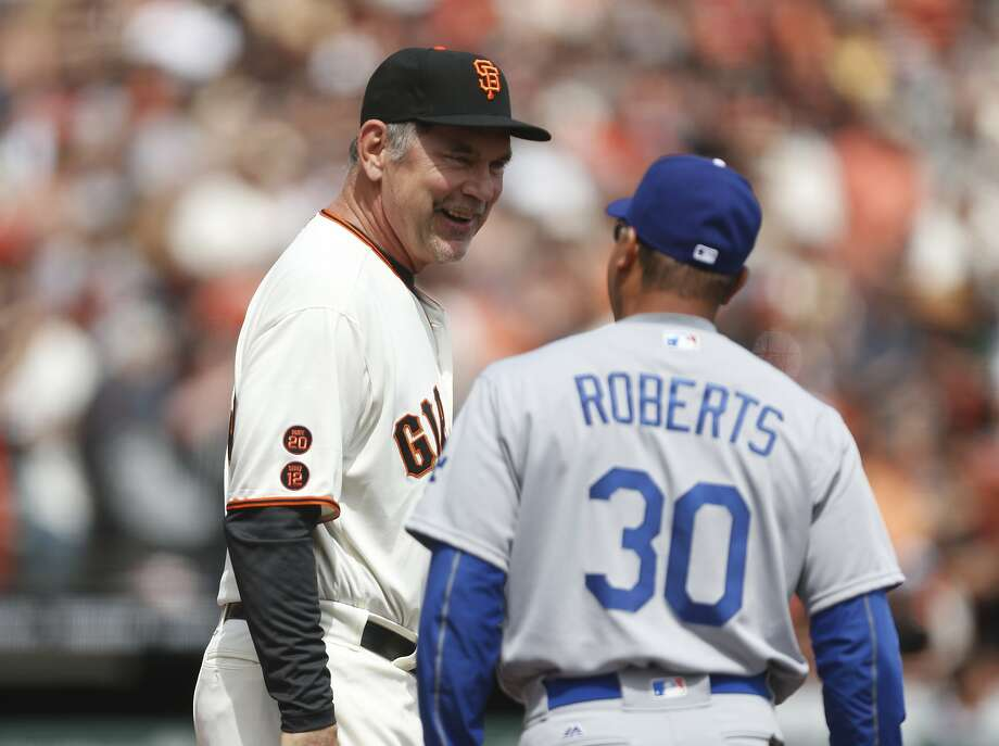 San Francisco Giants manager Bruce Bochy talks with Los Angeles Dodgers manager Dave Roberts before the home opening game on Thursday, April 7, 2016 in San Francisco, Calif. Photo: Beck Diefenbach, Special To The Chronicle