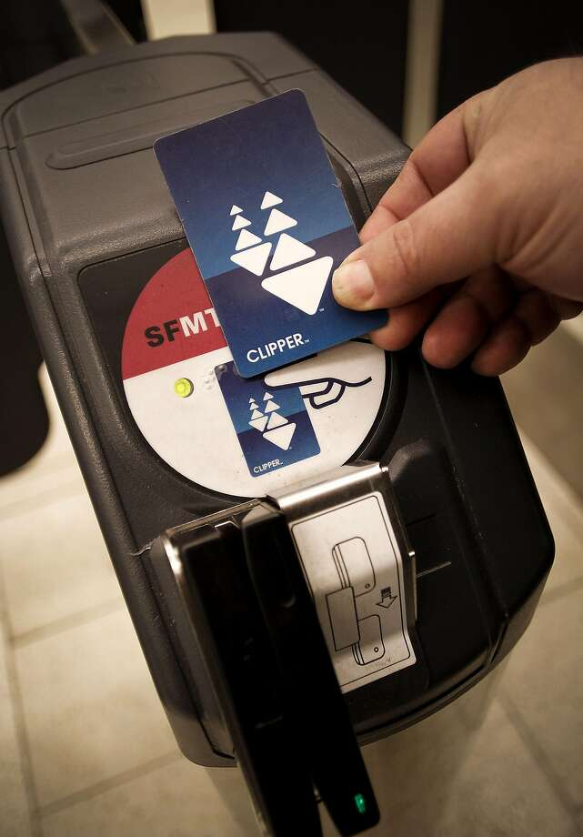 A passenger swipes the Clipper Card to access the MUNI station at the Powell Street BART station in San Francisco, Ca., on Thursday March 17, 2011. Photo: Michael Macor / The Chronicle 2011