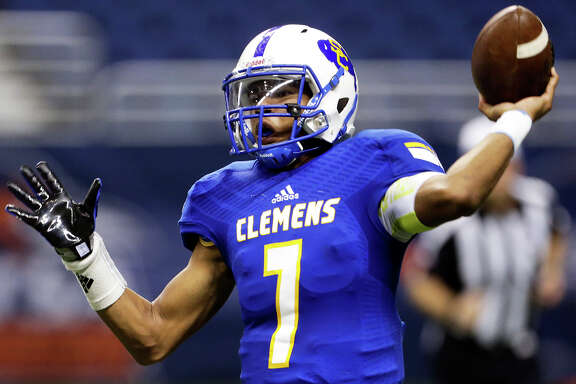 Buffaloes quarterback Frank Harris throws in the second quarter as Clemens plays Brandeis in the second round of the 6A Division II playoffs on Nov. 20, 2015.