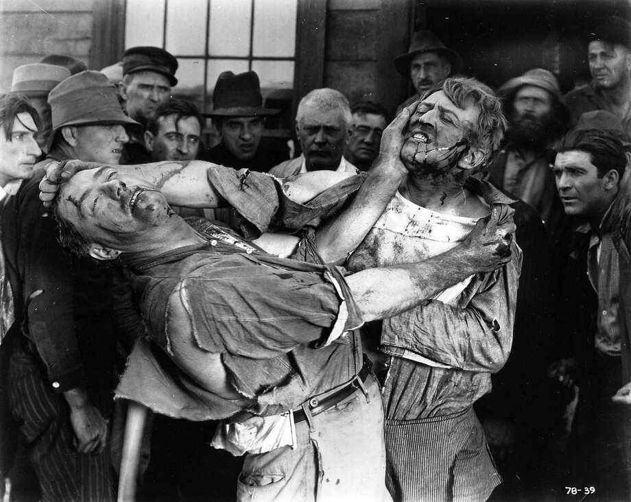 "Silent-era movie star Hobart Bosworth (right) grabs the hair of another man in a fight scene from 1919's ""Behind the Door."" Photo: Courtesy San Francisco Silent Film Festival"